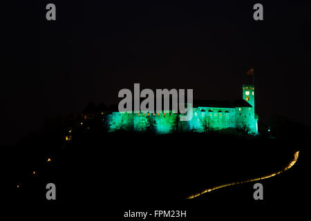 Ljubljana Castle, Slovenia. 19th March, 2016. Ljubljana Castle lit up green to celebrate its status as European - Stock Photo