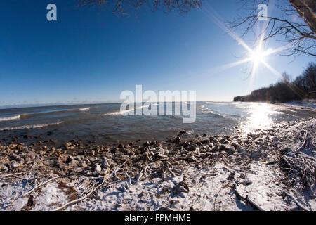 Fisheye lens of a frozen beach on the shoreline of Lake Michigan - Stock Photo