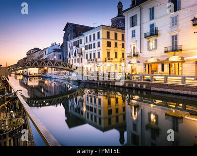 Bridge across the Naviglio Grande canal at the evening in Milan, Italy - Stock Photo