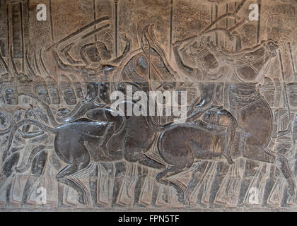 Angkhor Wat, Cambodia - January 29 2016:  Bas relief showing soldiers on horses with swords in the army of 11th - Stock Photo