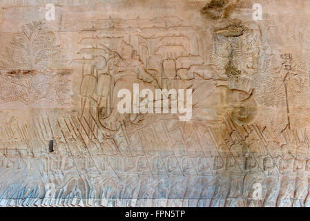 Angkhor Wat, Cambodia  Bas relief showing an officer or the king on an elephant and shaded by parasols - Stock Photo