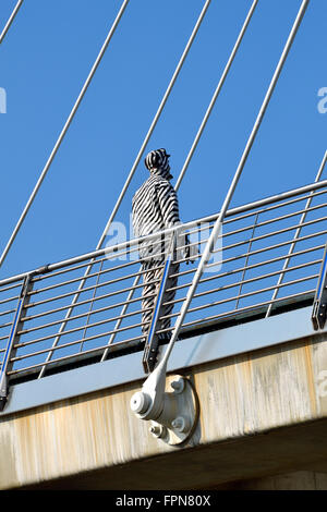 London, England, UK. 'Human Statue' on the Golden Jubilee Bridge (London Bridge) - Stock Photo