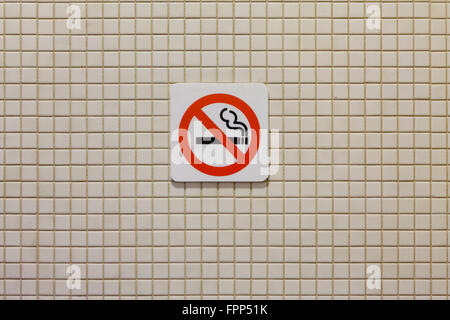 No smoking sign on bathroom wall - USA - Stock Photo