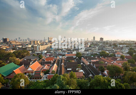 View of the Bangkok urban skyline from Wat Saket or the Golden Mount - Stock Photo
