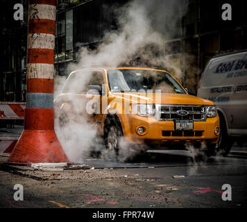 Taxi and steam vent, New York City, USA - Stock Photo