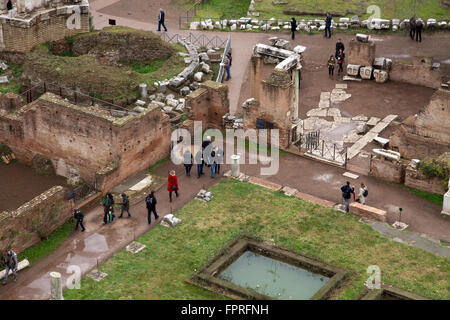 Roman Forum ruins tourists visiting Rome Italy ancient rests - Stock Photo