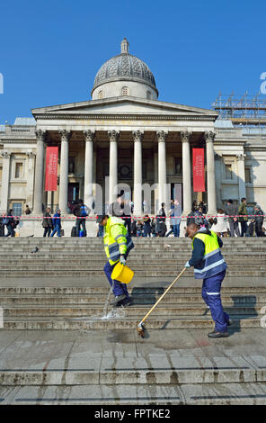 London, England, UK. Trafalgar Square: Men cleaning the steps in front of the National Portrait Gallery - Stock Photo