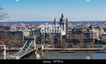 Budapest, Hungary - March 14, 2016: Szechenyi Chain Bridge over the Danube river and St. Stepen's Cathedral in Budapest, - Stock Photo