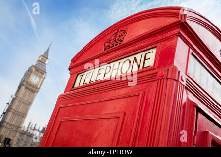 London telephone booth in front of  big ben - Stock Photo