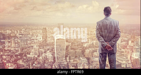 Businessman looking across the city of London financial district - Stock Photo