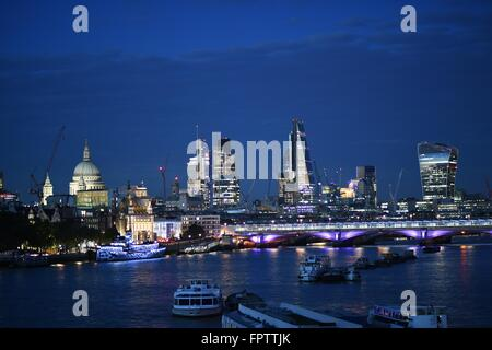 A Night Shot of beautifully lit London City overlooking The River Thames and famous landmarks - Stock Photo