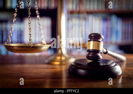 Gavel, scales of justice and law books - Stock Photo