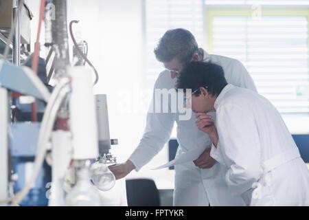 Two scientist working in a pharmacy laboratory, Freiburg Im Breisgau, Baden-Württemberg, Germany - Stock Photo