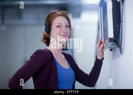 Young female engineer working on touchscreen computer monitor in an industry, Freiburg Im Breisgau, Baden-Württemberg, - Stock Photo
