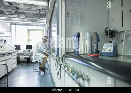 Two scientist working in a pharmacy laboratory, Freiburg Im Breisgau, Baden-Württemberg, Germany - Stock Photo