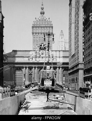 1930s STREET CONSTRUCTION IN FRONT OF GRAND CENTRAL STATION WITH SIGN WPA DEPRESSION AGENCY NEW YORK CITY USA - Stock Photo