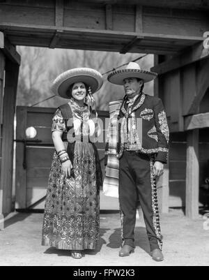 1930s PORTRAIT MAN WOMAN COUPLE WEARING TRADITIONAL CHARRO COWBOY AND CHINA POBLANO COSTUMES MEXICO CITY MEXICO - Stock Photo