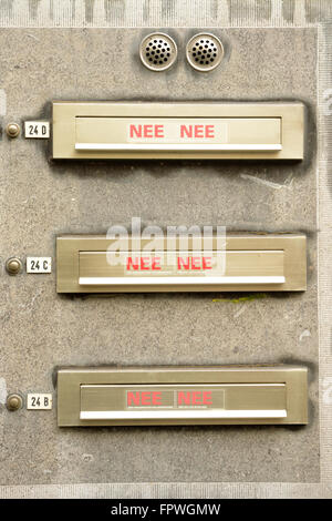 Mailboxes by apartment building in Maastricht. These people have chosen not receive either any junk mail or local - Stock Photo