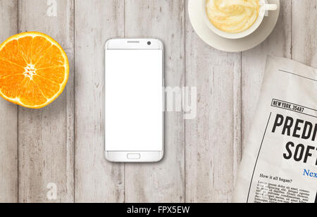 Smart phone with isolated display on table. Newspaper, coffee and orange. Top view. - Stock Photo