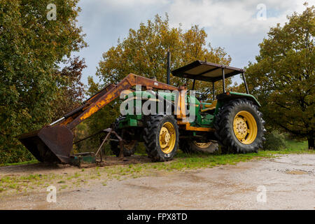 Old aged tractor - Stock Photo