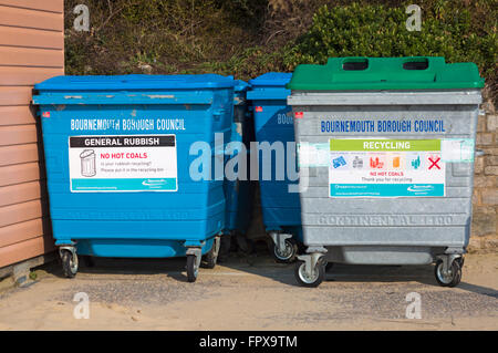 Bournemouth Borough Council recycling and general rubbish bins on promenade by beach huts at Bournemouth in March - Stock Photo
