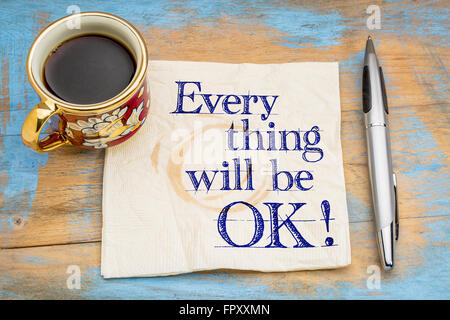 Everything will be OK! Handwriting on a napkin with a cup of coffee and pen. - Stock Photo
