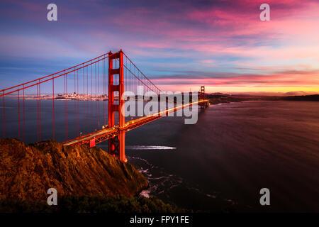 Colorful sunset at the Golden Gate Bridge in San Francisco, California, USA - Stock Photo