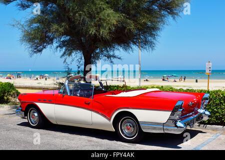 US car Oldtimer, Buick, parked at the beach promenade, Senigallia, Marche, Italy - Stock Photo