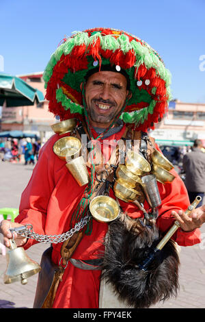 Water seller, Jemaa el-Fnaa, Place of the Hanged, Jugglers Square, Marrakech, Morocco - Stock Photo
