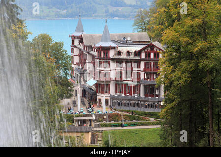 A photograph of the Grand Hotel Giessbach as seen from behind the Giessbach Falls on Lake Brienz in Switzerland. - Stock Photo
