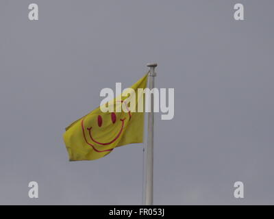 London, UK. 20th March, 2016. Somerset House raises Utopian flag for a year, created by artist Jeremy Deller and - Stock Photo