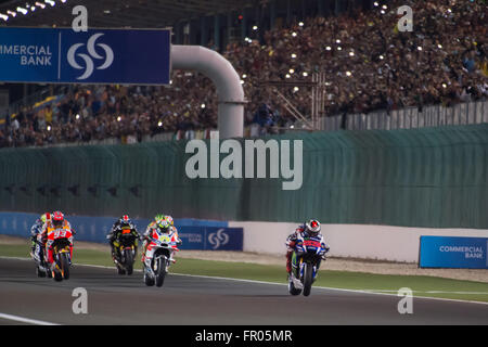 Losail International Circuit, Qatar.  20th March 2016.  Jorge Lorenzo leads during the start of the MotoGP race - Stock Photo