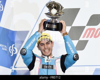 Doha, Qatar. 20th Mar, 2016. Spanish Moto2 rider Luis Salom of the SAG Team holds his trophy on the awarding podium - Stock Photo