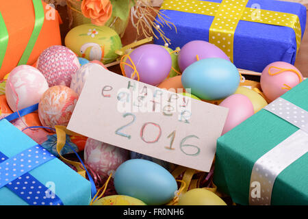 Arrangement of gift boxes in wrapping paper with checkered ribbons arrangement of gift boxes in wrapping paper with checkered ribbons and decorated easter eggs isolated on negle Gallery