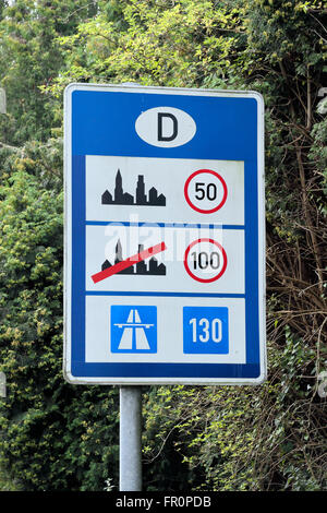 Road side sign indicating speed limits as you enter Germany (from Holland). - Stock Photo