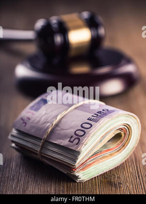 Judge's hammer gavel. Justice and euro money. Euro currency. Court gavel and rolled Euro banknotes. Representation - Stock Photo
