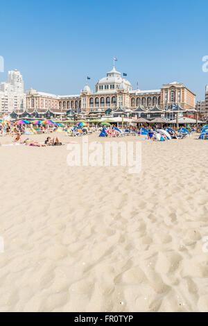 People on Scheveningen beach and skyline with Kurhaus in the city of The Hague, Netherlands - Stock Photo