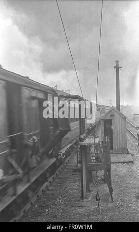 Train showing working of Travelling Post Office apparatus - Stock Photo