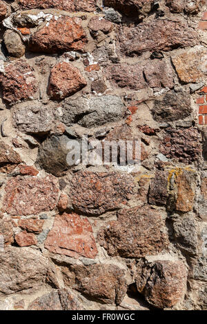 Rough natural old stone wall as background - Stock Photo