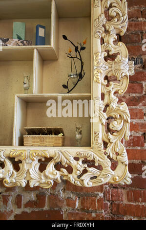 Shelf with an ornament on a brick wall - Stock Photo