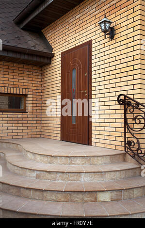 Beautiful input in a modern cottage from a brick - Stock Photo