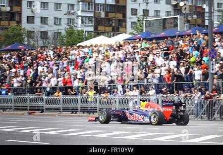 KYIV, UKRAINE - MAY 19, 2012: Daniel Ricciardo of Red Bull Racing Team drives RB7 racing car during Red Bull Champions - Stock Photo