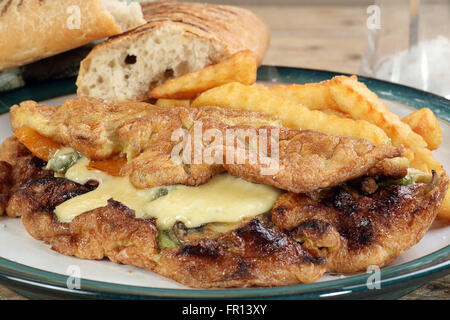 cheese mushroom and sweet pepper omelette with fries - Stock Photo