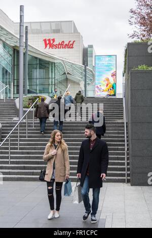 Couple shopping in Westfield Shopping Centre in Shepherd's Bush, White City, London, UK - Stock Photo