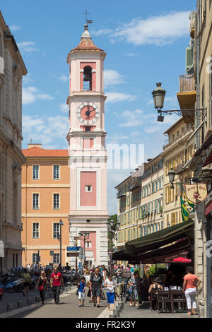 Nice, Cote d'Azur, French Riviera, France. Vieille Ville, the Old Town.  View down Rue de la Prefecture to the clock - Stock Photo