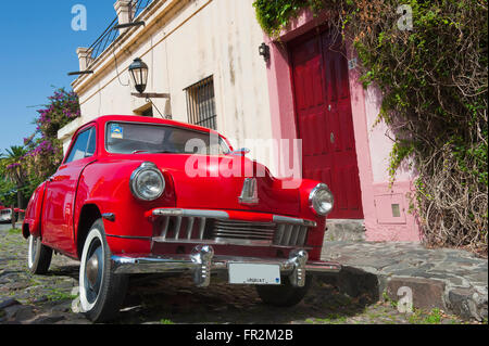 Vintage car in front of a house, Colonia del Sacramento, Uruguay, South America - Stock Photo