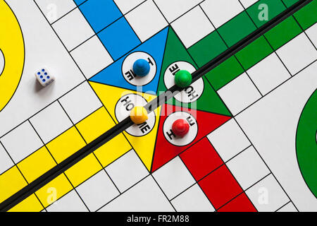 Close up detail of Ludo game with dice and pieces - Stock Photo