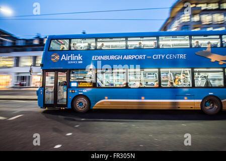 Double decker bus at Princes Street in Edinburgh, Scotland in UK. - Stock Photo