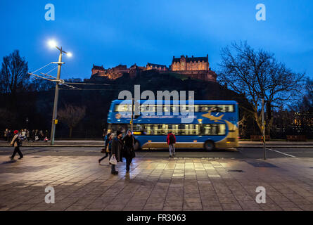 Double decker bus at Princes Street in Edinburgh, Scotland in UK. Edinburgh Castle on background - Stock Photo
