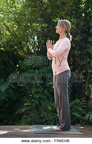 profile of woman in yoga pose - Stock Photo